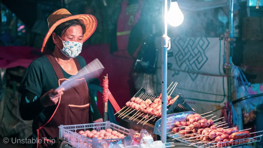 thai streetfood lady with sausages