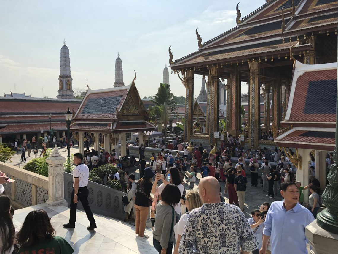crowd around a temple in bangkok