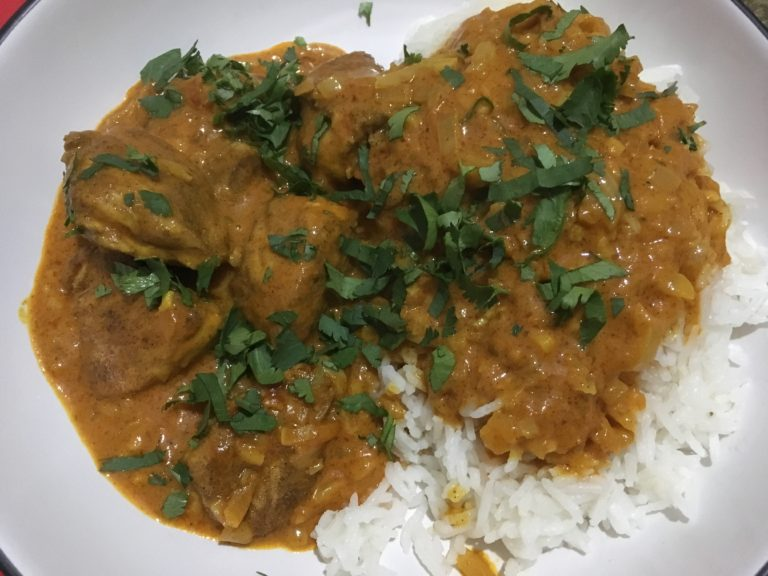 plate with rice and butter curry chicken