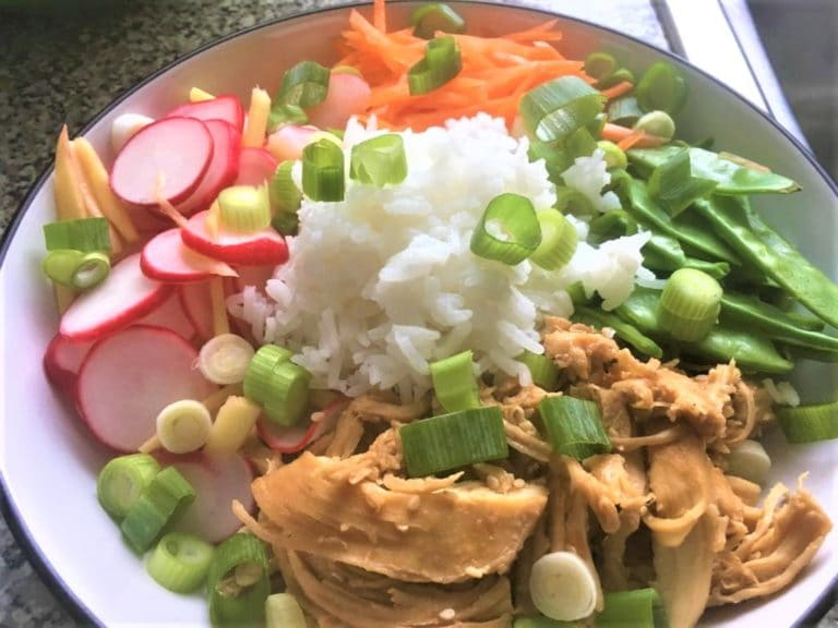 plate with chicken rice and vegetables