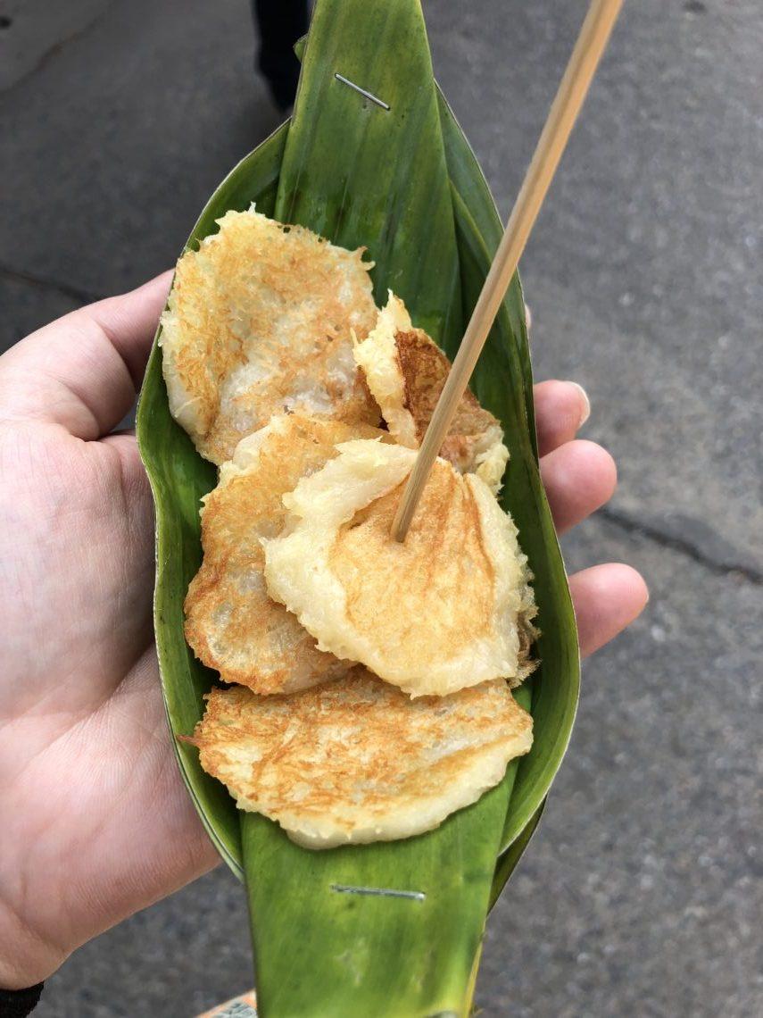 thai coconut pancakes on a small banana leaf plate